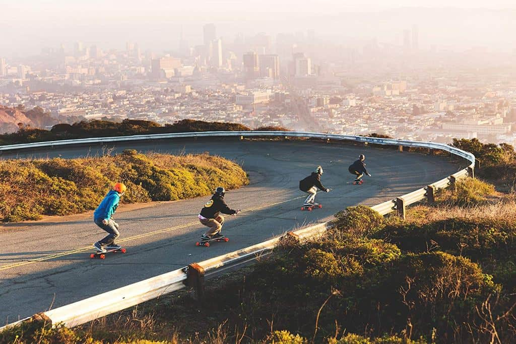 group of skaters at a curve road