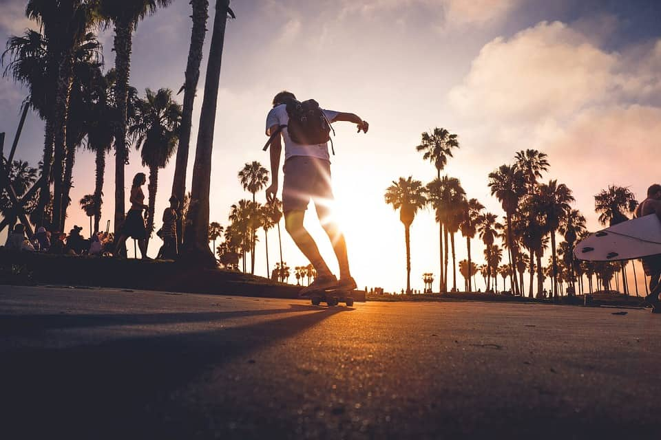 a man longboarding during sunset