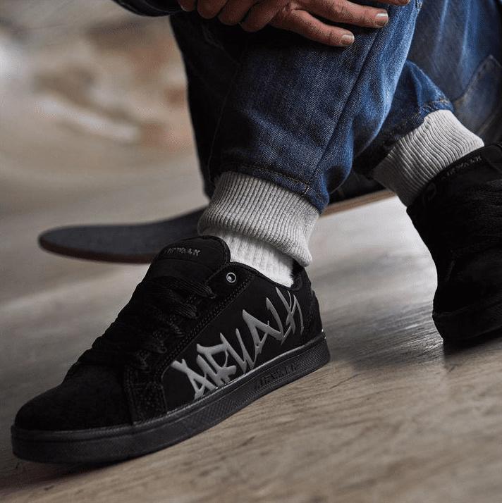 Black airwalk skate shoes being worn