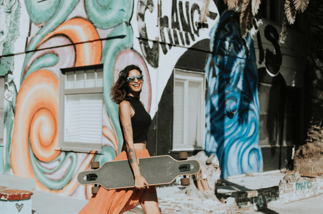 Woman carrying her DB longboards
