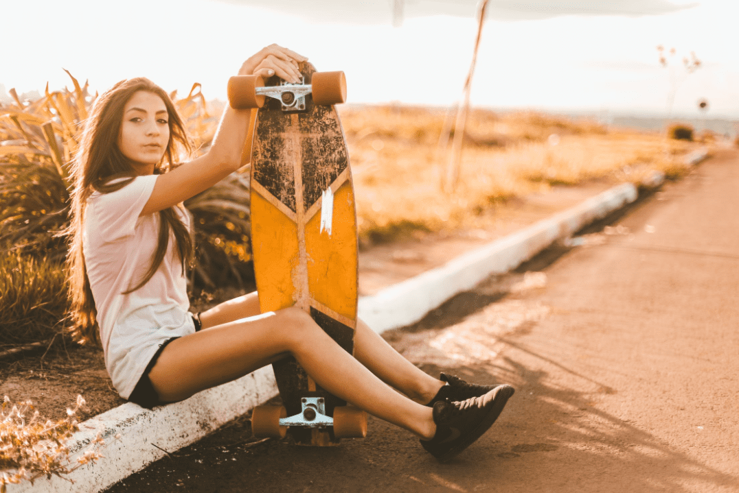 Woman sitting with her DB longboards