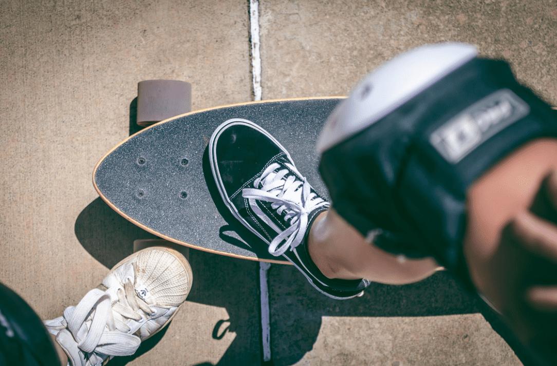 Foot on a Arbor Longboard