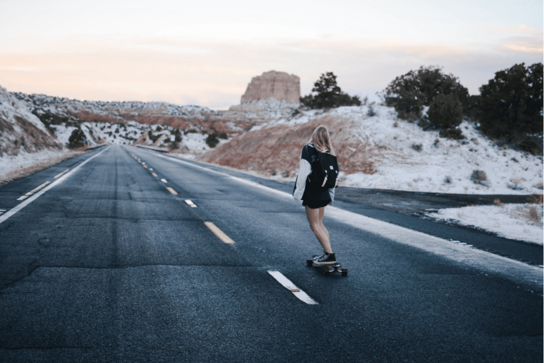 Woman longboarding in the road using her DB longboards