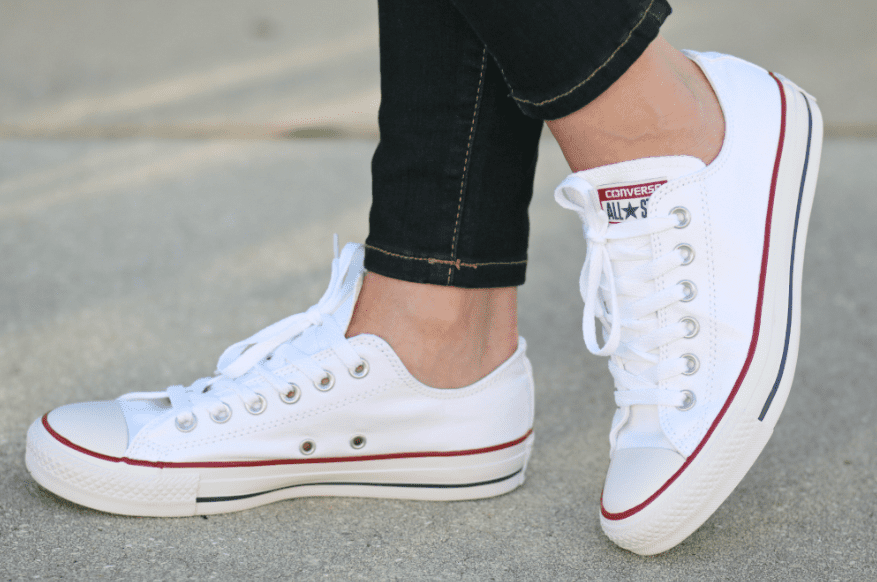 White converse shoes worn by a woman